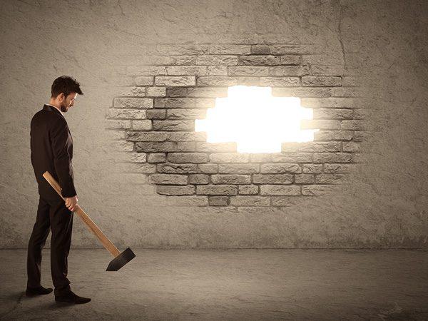 overcoming addiction stigmas - man breaking through wall - great oaks recovery